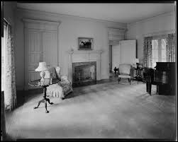 leslie combs interior of home room with fireplace and piano