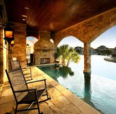 infinity pool house ideas pool beach style with pool house bar infinity pool house ideas pool traditional with spa oval outdoor dining tables