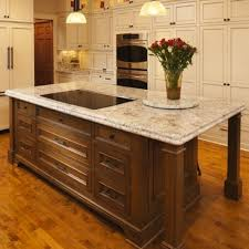 kitchen with island and breakfast bar iu5 walnut breakfast bar island with granite top bydesign
