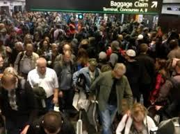 denver airport meltdown delays wednesday thanksgiving flights
