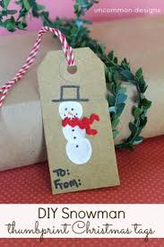 diy reindeer and snowman thumbprint tags a gift in