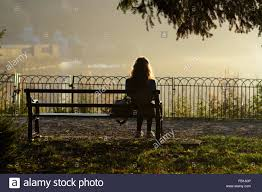 on park bench silhouette nottingham england stock photo