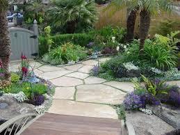 small wooden bridge and sleek flagstone patio designs using lush
