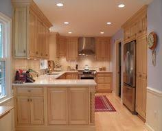 maple cabinets with black granite countertops very dramatic hard