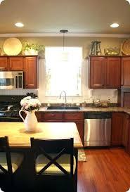 decorating above kitchen cabinets ideas kitchen decorating ideas above cabinets decorating above kitchen