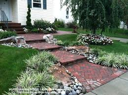 Front Yard Walkway Landscaping Ideas - brick walkway lined with colorful flowers inexpensive front yard