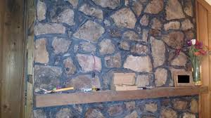 fireplace mount tv in stone facade or drill through to chimney