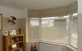 patterned roman blinds privacy wooden venetians bay window