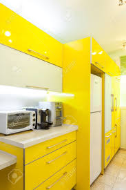 green and yellow kitchen decor with white tile and refrigerator