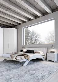lovely attic minimalist bedroom designs with white wooden bed
