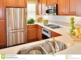 oak kitchen cabinets with stainless steel appliances residential model home kitchen stock photo image of estate