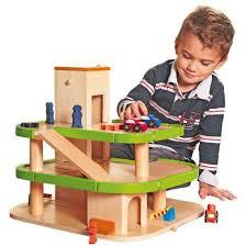 bestel houten speelgoed garage met lift in de winter winkel