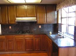 kitchen black granite countertops with dark cabinets brushed