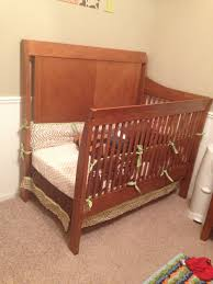 quick not to mention cheap solution for crib to toddler bed
