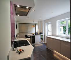 this kitchen design features two tower runs a peninsular seating