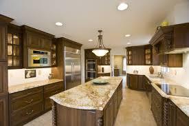 kitchen ceiling light cooktop range hood ceramic floor brown