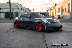 custom black nissan 350z low and slow nissan 350z on red gf7 wheels by mrr u2014 carid com gallery