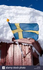 Sweedish Flag A Swedish Flag On A Cottage Covered With Snow Sweden Stock Photo