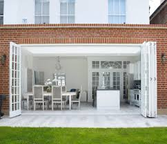 bifold french doors dining room traditional with artificial plants