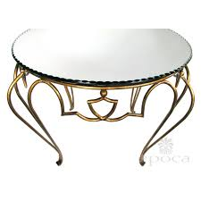a chic french art deco gilt iron circular table with mirrored top