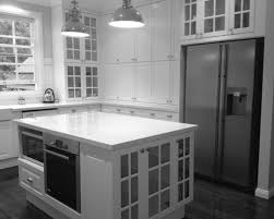ikea kitchen showroom with white cabinetry with granite countertop