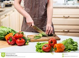 young woman cooking in the kitchen at home a woman cuts a