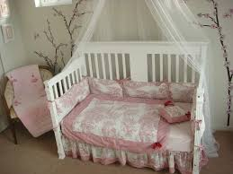 toile bedding in kids eclectic with baby cot next to cherry
