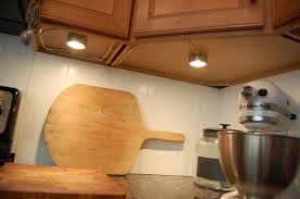 simple puck lights under cabinet lighting example kitchen decoration with lights view original pic full large
