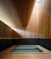kubo tsushima creates curved interior inside bathhouse