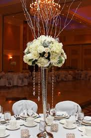 Wedding Centerpieces With Crystals by All White Flowers On Top Of Chic Vase With Crystal Chandelier