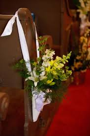 wedding flower arrangements for church pews white green flowers