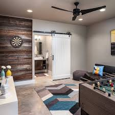 Sliding Barn Doors A Practical Solution For Large Or by Basement Remodel With Barn Door Hardware And Reclaimed Beam Wall