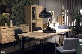 tropical dining room furniture wooden cabinets and dining table grayish blue chair black pendant