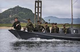 china prepares for a crisis along north korea border wsj