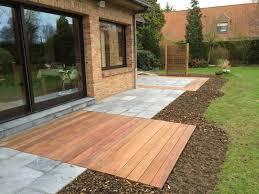 auvent en bois pour terrasse terrasse pierre bleue et bois exotique à verlinghem 59 nord