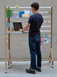 Standing Desk For Cubicle Why This Modern Adjustable Standing Desk Is Genius Brit Co