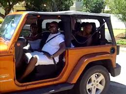driving a jeep wrangler driving the jeep wrangler with no doors