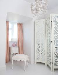 provencal white dressing stool in a beautiful dressing room