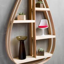 minimalist wooden shelf in shape of teardrop mid century