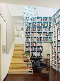 modern small home library with bookcase beside staircase