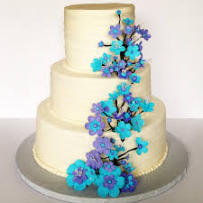 wedding cake gum buttercream wedding cake with purple and blue gum paste cascading