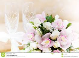 wedding bouquet and wine glasses in the background stock photo