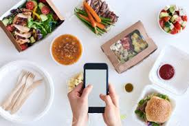 gourmet food delivery holding smartphone mobile cellphone different types