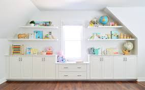 Bookshelves And Cabinets by Adding Built Ins U0026 White Floating Shelves Around A Window Niche