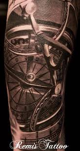 realistic compass tattoo idea by remis tattoo