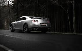 silver nissan silver nissan gt r against the dark forest wallpapers and images