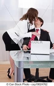 sous le bureau sensuous seducing businessman at desk in office stock