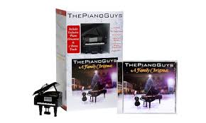 a family cd and piano ornament package the piano guys