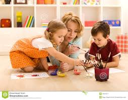 kids painting hands with their mother royalty free stock