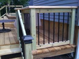 image of new wooden patio railings deck railing metal pipe rails